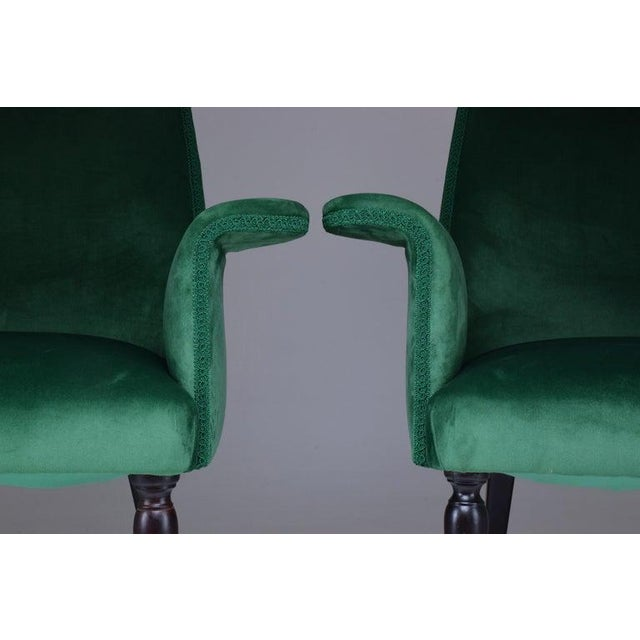 A set of two midcentury armchairs by notable Italian designer Osvaldo Borsani, circa 1940s. These have been expertly...