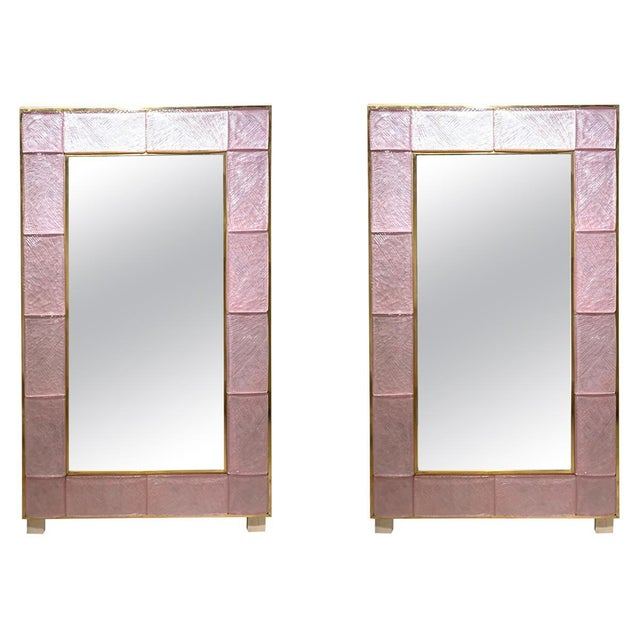 Fabulous modern pink Murano glass and brass mirrors. Gorgeous pink glass framed in brass. Creates a very decorative high...