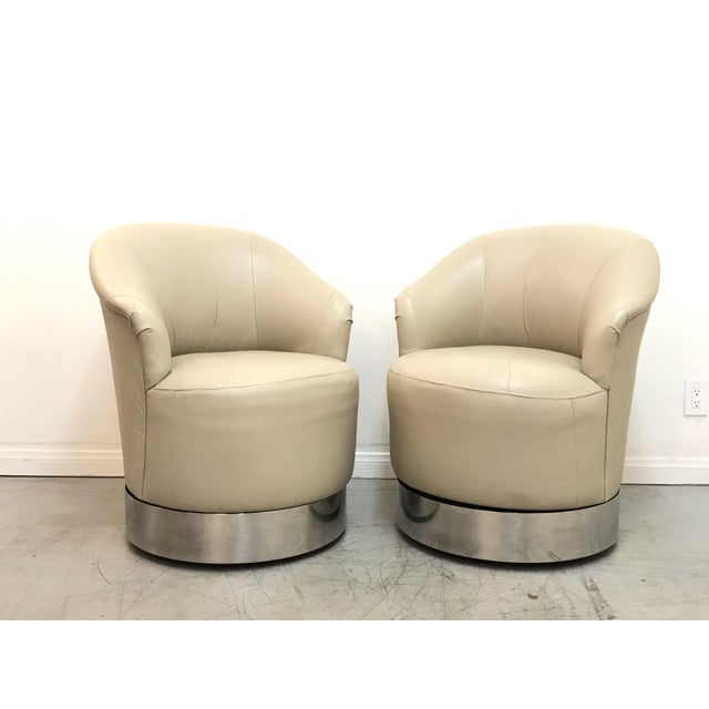 Pair of Sally Sirkin Lewis Lambskin Swivel Chairs on Casters for J. Robert Scott in excellent vintage condition. Chairs...