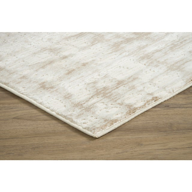 Bixby Taupe creates a smooth, peaceful atmosphere through use of a sandy color palette and elegant design. This Stark...