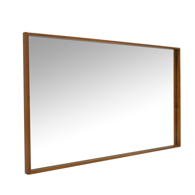 This big, beautiful wall mirror designed by T.H. Robsjohn-Gibbings for Widdicomb has a deep frame of bleached walnut and...