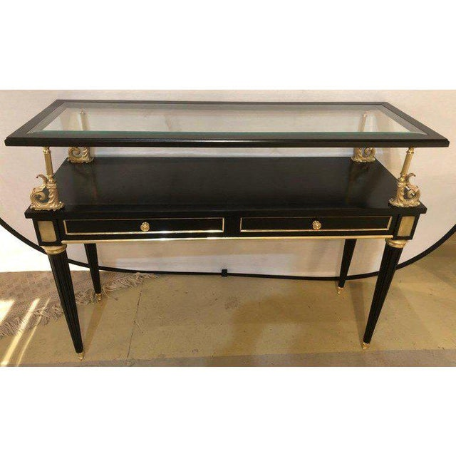An ebony and bronze mounted Hollywood Regency serving cart or étagère. Server / Console table in the manner of Maison...