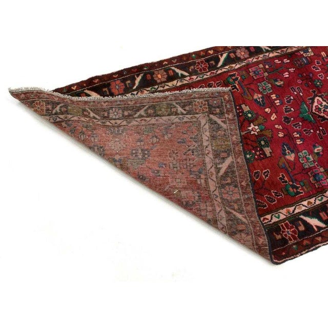 Rich Red hand-tied Persian Saruq wool runner rug with think pile. Lovely floral patterns and details in green, blue,...