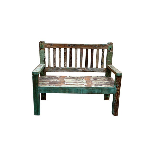 A multicolor patio bench with petite proportions featuring a straight slatted back and colored aged patina.