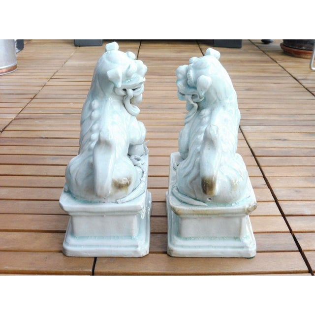 Ceramic 18th C / 19th C Qing Dynasty Chinese Celadon Foo Dogs - a Pair For Sale - Image 7 of 13