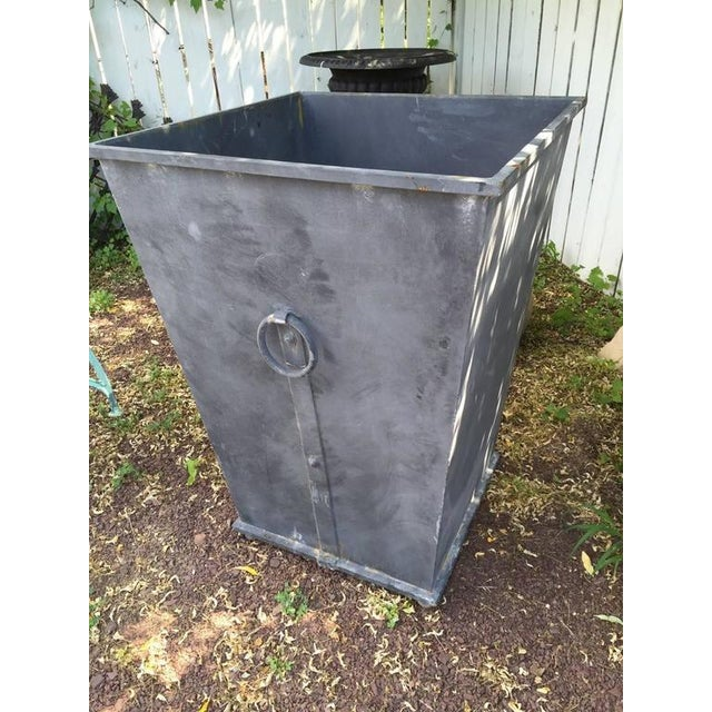 Pair of square steel planters with lead colored finish and handsome ring details.