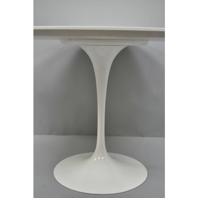 """Item: Contemporary White Saarinen Style Tulip Base 47"""" Round Dining Table Details: Metal tulip form base, round wooden..."""