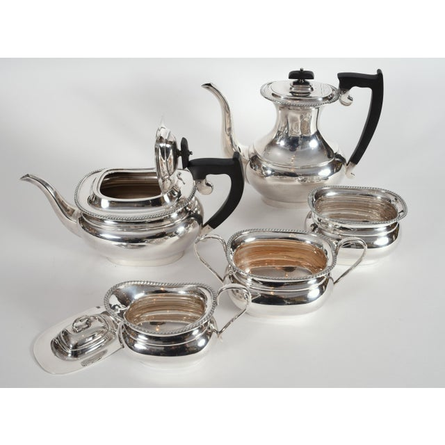 Vintage sterling silver English Sheffield five pieces tea and coffee service with black wood handle. Each piece is in...