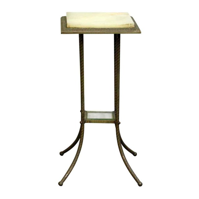 Features a square marble top framed in floral metal detailing with one bottom glass shelf. Made in the late 20th century.