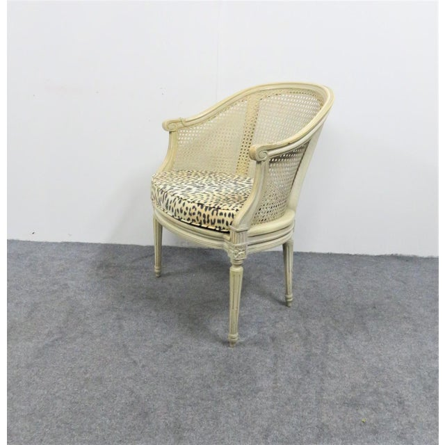 Louis XVI style arm chair , cream painted frames , caned sides and seat, removeable Leopard print cushion