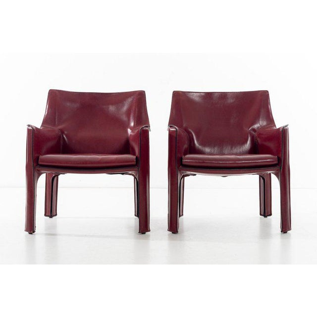 Bellini for Cassina, cab chairs in oxblood Italian leather, high-quality chairs consists of a leather cover stretched over...