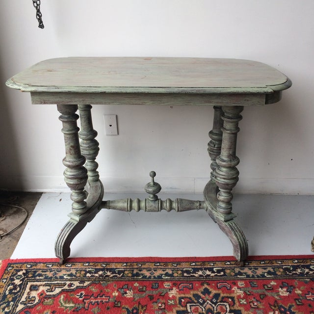 Beautiful gray dining table with cottage chic appearance. Perfect for an intimate dining space, foyer, or library.