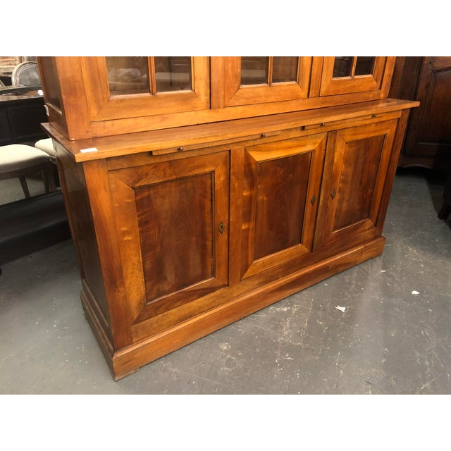 Late 19th. C. French Louis Philippe bibliotheque hutch done in walnut. Bookcase having individual glass astragal panes...