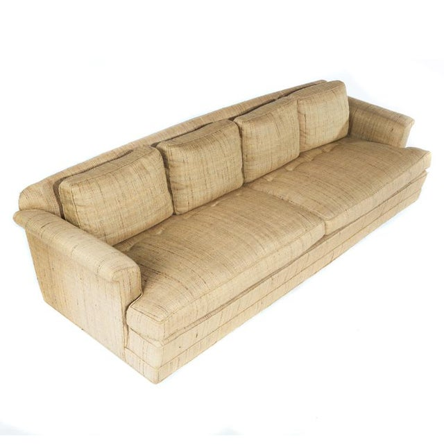 Classic Dunbar form with down-stuffed seat and back cushions. Raised on casters. Large, deep and comfortable, with high-...