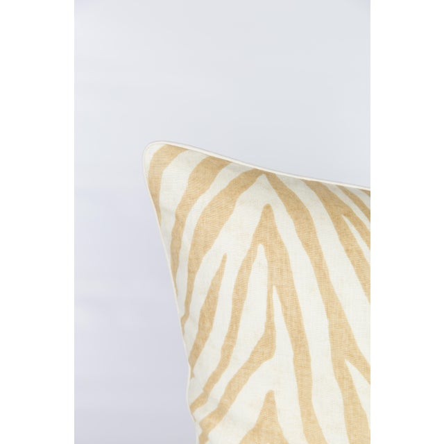Pair of custom caramel and ivory linen zebra pattern pillows. Pattern on fronts and backs, complemented with premium ivory...