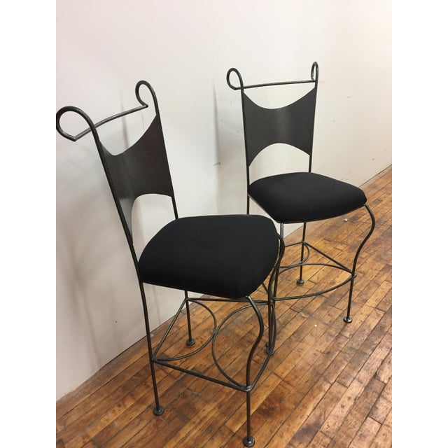 This strikingly handsome pair of sturdy, Mid-Century Modern wrought iron bar stools by Arthur Umanoff will add a big dose...