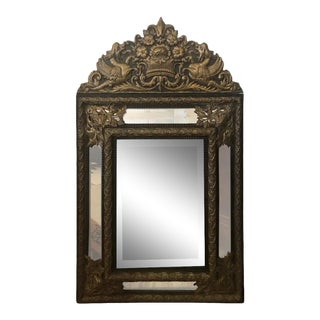 Antique Repousee Brass and Ebonized Cushion Mirror For Sale