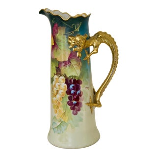 Early 20th Century Hand-Painted Gilt Dragon Handled Porcelain Pitcher by Limoges For Sale