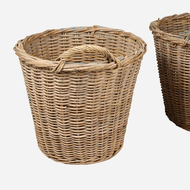 Vintage found wicker bacskets with a single handle. Vintage/antique items may contain cracks, breaks, and imperfections....