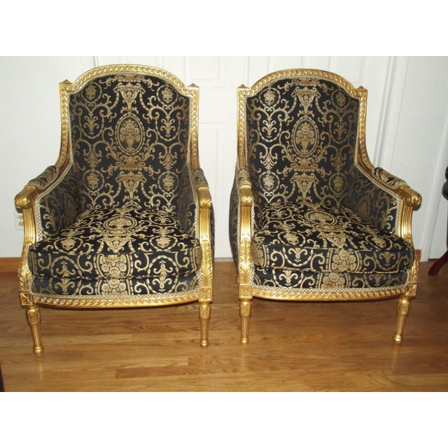 Stunning 20th Century Louis XVI Style gilt wood bergeres. This pair has magnificent detail and design. It features two...