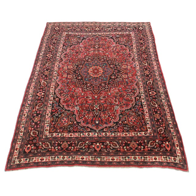 For sale is an antique Persian Mashad rug. Made of hand-knotted wool. Gorgeous floral design.