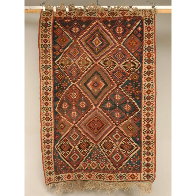 Vintage Persian Kilim rug form our store owner's personal collection. Kilims are produced by tightly interweaving the warp...