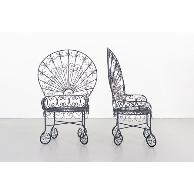 This listing is for a set of two Peacock chairs that are designed by John Salterini. They are from the USA circa 1930's....