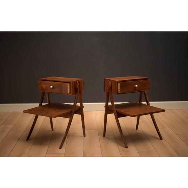 Vintage Drexel Declaration nightstands or bedside tables designed by Kipp Stewart and Stewart MacDougall in walnut. This...