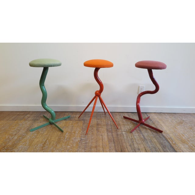 Set of three bar stools by Patrice Goujon. Stools of steel tubing coated with enamel paint. Each stool is signed and...