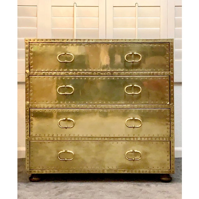 Vintage brass dresser made in Spain by Sarreid Ltd. Made of wood and wrapped on all sides with brass. This dresser has...