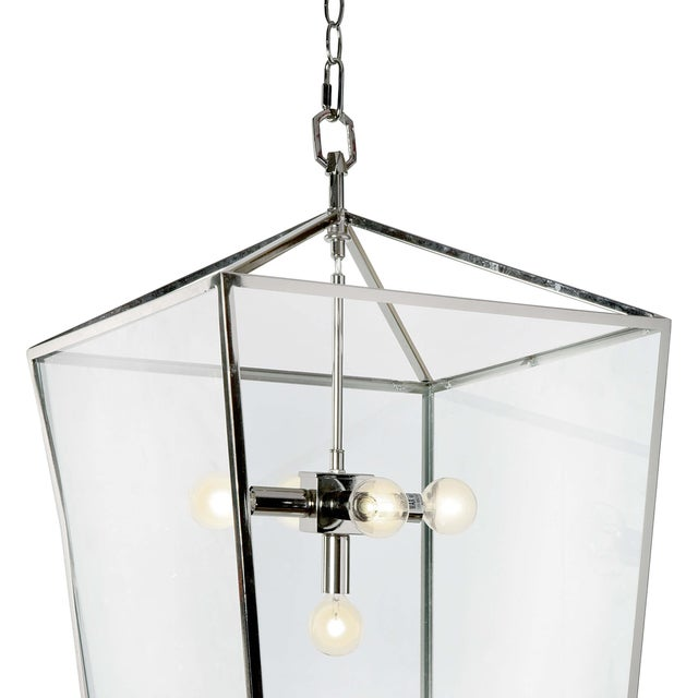 Timeless elegance with a lantern that is radiating refined. This clean-lined lantern is crafted of steel with a polished...