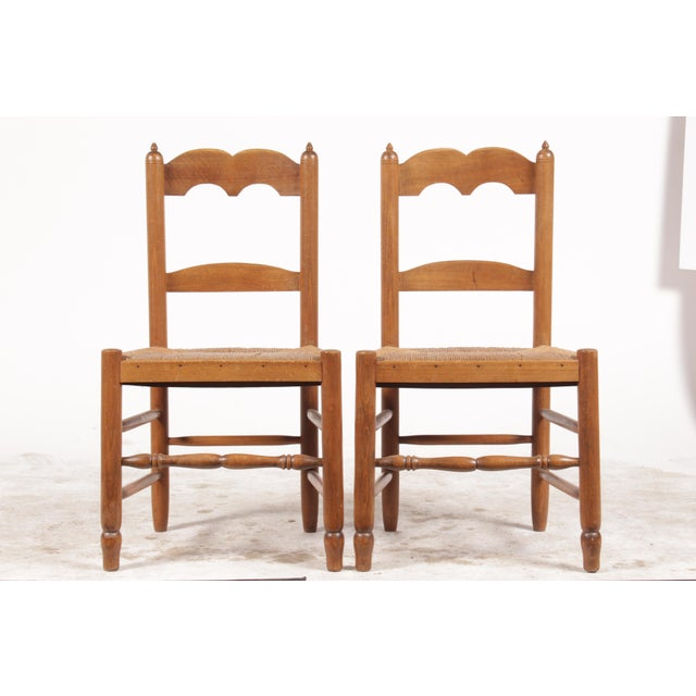 Pair of petite French-Country Style chairs featuring double arch splat backs, finials and rush seats.
