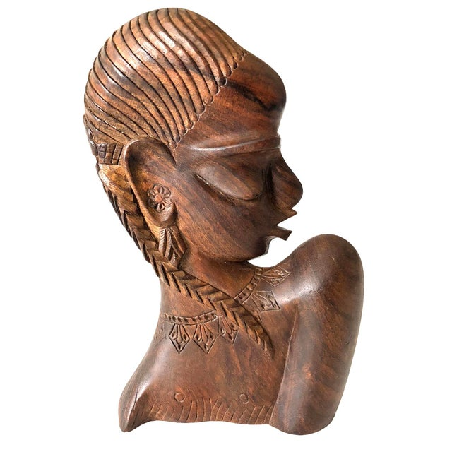 Vintage hand-carved wooden female bust. Gorgeous detail on the hair braid, necklace, and face.