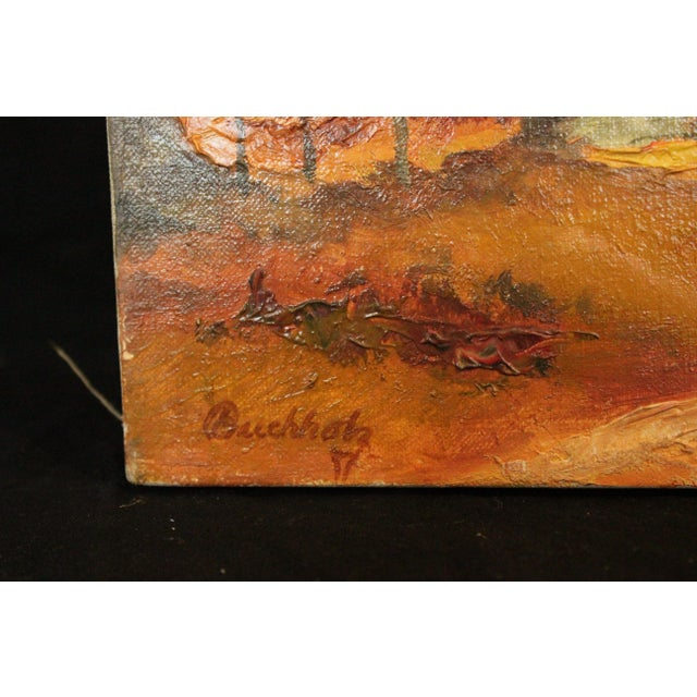 An unframed autumn landscape signed Buchholz. Oil on Canvas. Lyme Art Association on back.