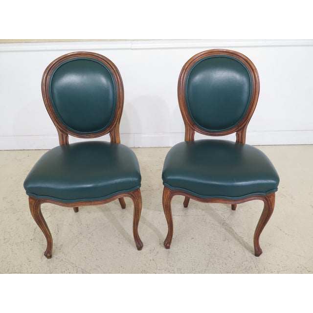 Set of 6 green leather French style dining room chairs. Approx: 20 years old. Quality construction. 18 C. design. French...