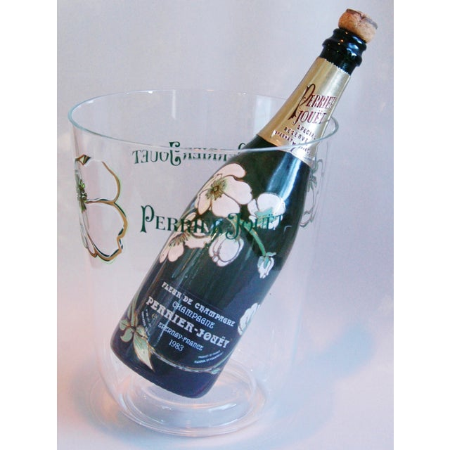 """French Champagne acrylic ice bucket. Front and back reads """"Perrier-Jouët."""" Bottle in photo not included. Minor wear."""