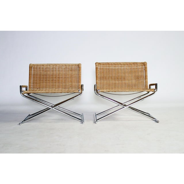 Pair of rattan sled chairs on chrome frame by Ward Bennett for Brickel Assoc., 1984. Labelled.