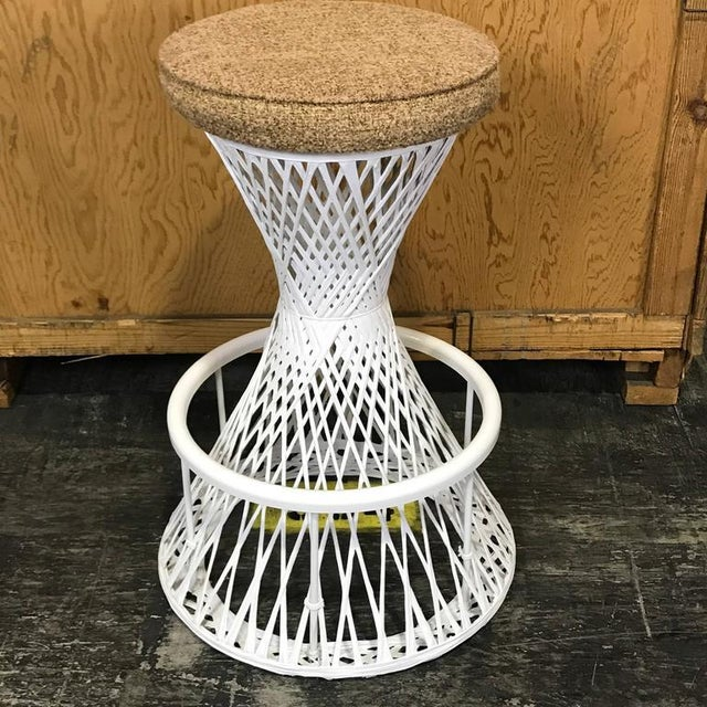 """Pair of woven and spun fiberglass Woodard bar stools, each one with 15.75 D seat, standing 30"""" H and supported on a 20"""" D..."""
