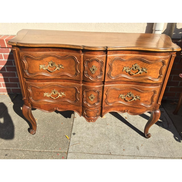 Walnut Dresser, carved drawer fronts, dovetailed drawers. Made circa 1950 this is in excellent condition. No makers marks...