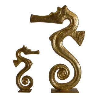 Modernist Gold Seahorse Sculptures on White Marble - A Pair For Sale