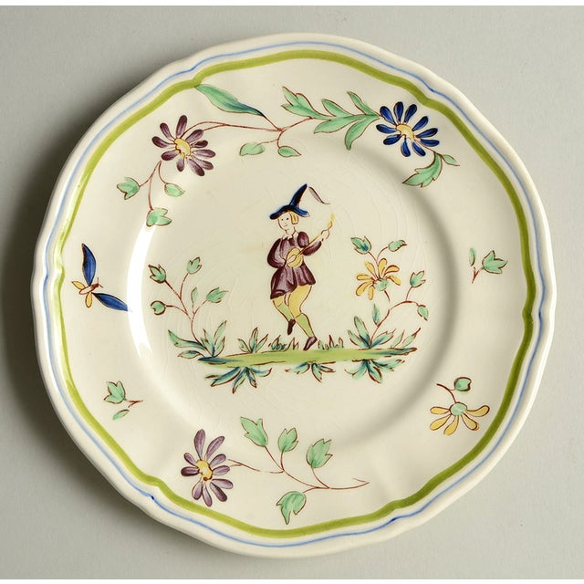 Longchamp Moustiers Appetizer PlateS/8 features a peasant minstrel surrounded by purple and blue flowers with green...