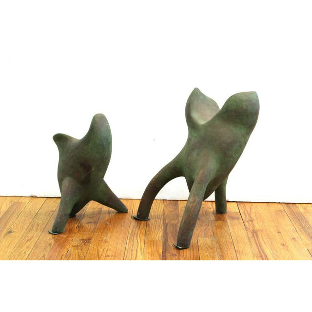 Modern abstract pair of art studio tripod sculptures in ceramic. The pair are of abstract organic shape and have a green...