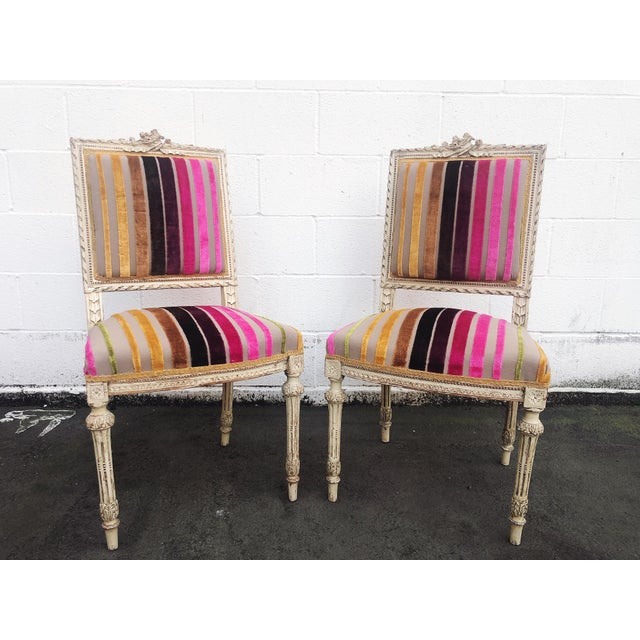 Fabulous pair of 19th century French Louis XVI hand carved wood side or hall chairs. The frame is highly detailed and the...