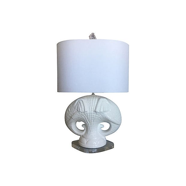 Safari chic! Large and fabulous mid-century Italian glazed porcelain lamp featuring matching double elephant heads on a...