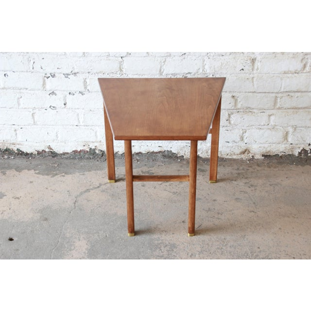 Offering an exceptional mid-century modern walnut cantilever wedge end table designed by Edward Wormley for Dunbar...