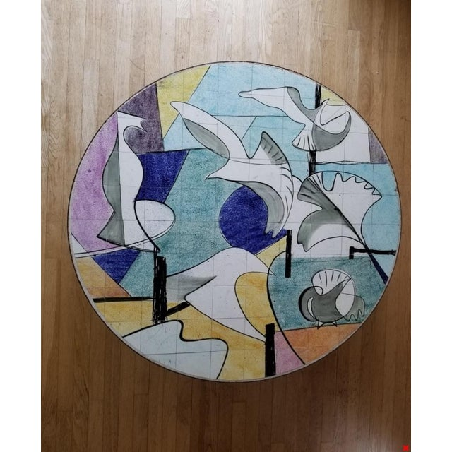 Stylish and high-quality Mid Century Handcrafted Cocktail table with exquisite ceramic tile tabletop . Handpainted with a...