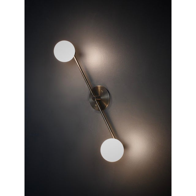 Segment wall lamp or flushmount ceiling fixture by Blueprint Lighting, 2020. A handsome study in clean lines and simple...