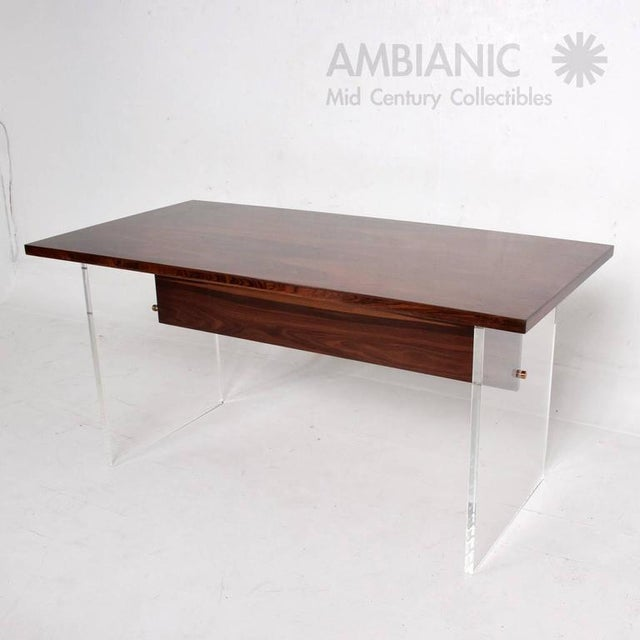For your consideration a beautiful table in rosewood and Lucite legs with custom brass hardware screws. Rosewood top has...