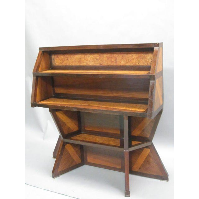 An extraordinary Italian Futurist work of sculpture which functions as an etagere, secretary, desk, bookcase or shelves....