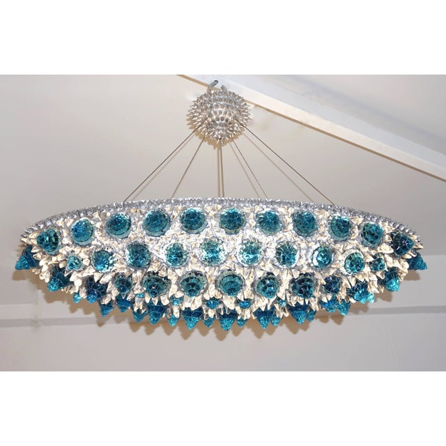 A jewel like Italian oval pendant or flush mount chandelier, Work of Art sculpture, entirely hand crafted, the...